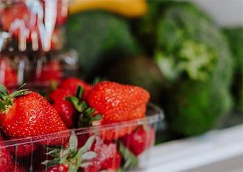 Strawberries and broccoli in fridge